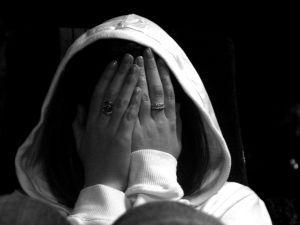 Woman Hiding Face