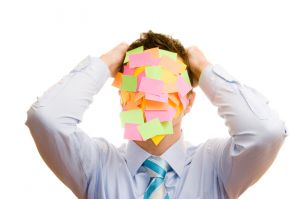 Man's face covered with post-it notes