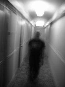 Shadowy figure in a hallway