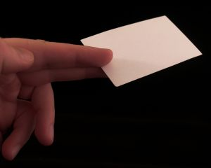 Hand offering a blank business card