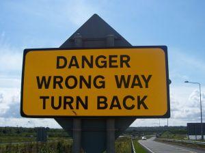 Danger, wrong way, turn back warning sign