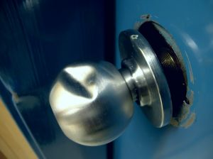 Broken doorknob from a forced entry crime