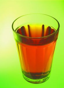 Glass of pink liquid (kool-aid)