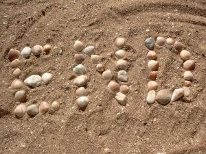 "Rocks and shells spelling out ""END"" on a beach"