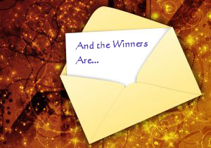 "Invitation half out of an envelope with the words ""And the Winners Are..."""
