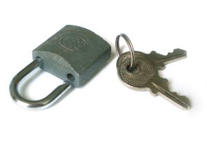 Opened padlock and keys