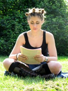 Woman reading in a park on a sunny day