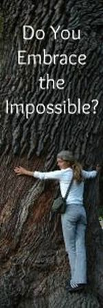 Woman hugging a tree bigger than she can get her arms around