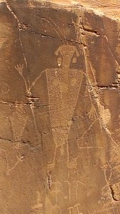 Rock face with petroglyph of native figure
