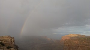 One end of a double rainbow over a canyon
