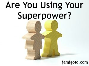 Wooden figures holding hands with text: Are You Using Your Superpower?