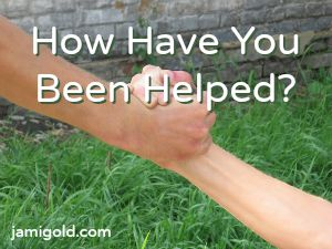Hands grasping to help with text: How Have You Been Helped?