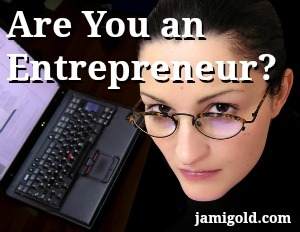 Serious woman at a laptop with text: Are You an Entrepreneur?