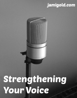 Microphone against a blank wall with text: Strengthening Your Voice