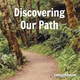 Dirt path through trees and ferns with text: Discovering Our Path