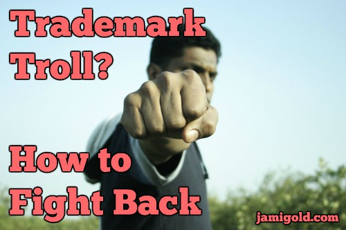 Man holding out fist with text: Trademark Troll? How to Fight Back