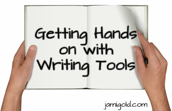 Hands holding an open book with text on pages: Getting Hands on with Writing Tools
