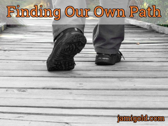 Close up of shoes crossing wooden footbridge with text: Finding Our Own Path