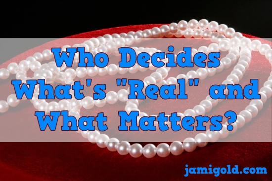 "Pearl-style necklace with text: Who Decides What's ""Real"" and What Matters?"