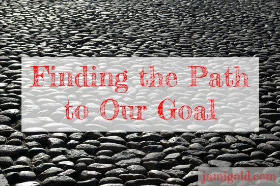 Featureless stone-covered expanse with text: Finding the Path to Our Goal