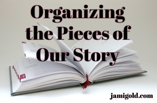 Planner book open on a surface with text: Organizing the Pieces of Our Story